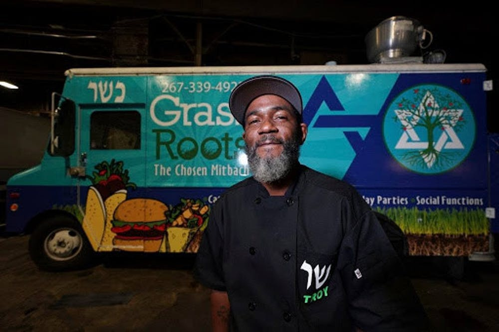 <p>Troy Harris in front of his Grassroots Kosher food truck </p><p>Credit YeahThatsKosher</p>