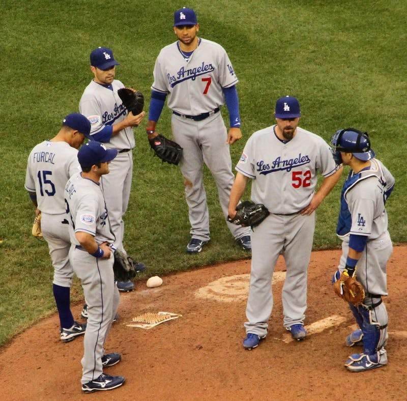 Multiple L.A. Dodgers players stand around the pitching mound, April 24, 2010. Flickr, Photo Courtesy