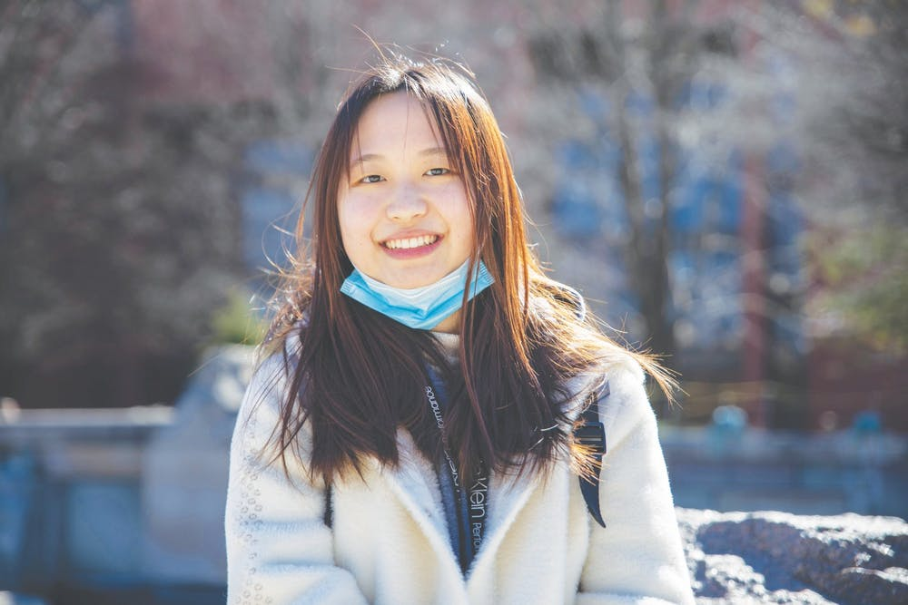 <p>Senior journalism major Shiyi Sun smiles in front of Frog Baby March 2, 2021. Sun will graduate from Ball State in May and has already purchased her plane ticket back home to China. <strong>Jaden Whiteman, DN</strong></p>