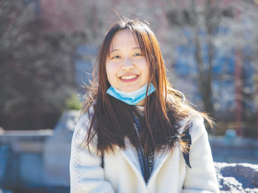 Senior journalism major Shiyi Sun smiles in front of Frog Baby March 2, 2021. Sun will graduate from Ball State in May and has already purchased her plane ticket back home to China. Jaden Whiteman, DN