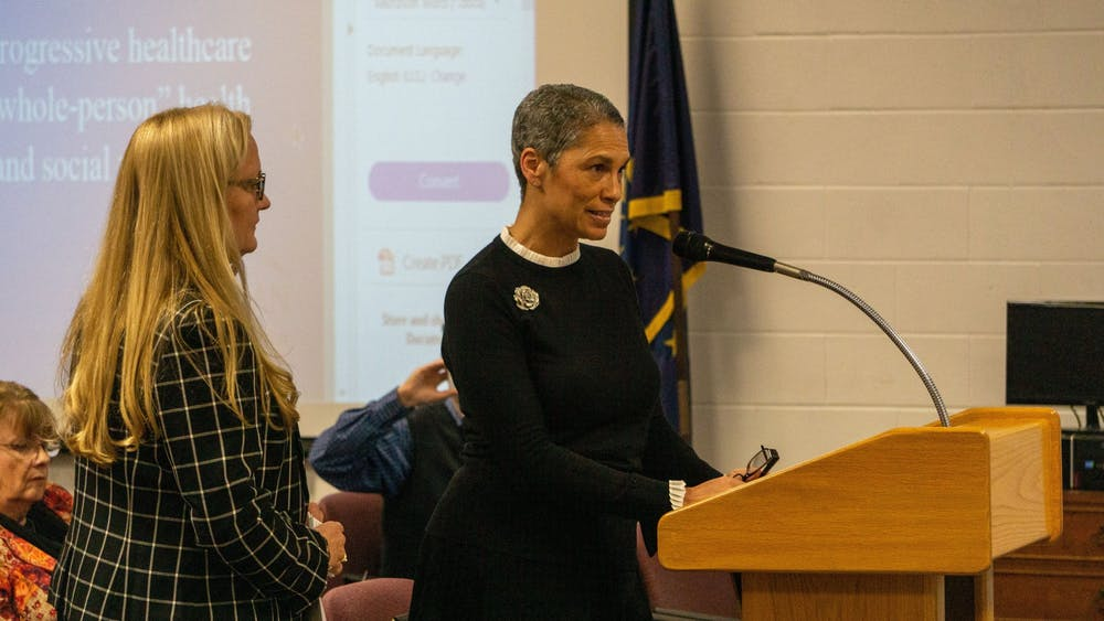 <p>(Left to right) Meridian Health Services' Lisa Suttle, regional vice president of clinical services, and Tracy Douglas-Wheeler, vice president of community health, speak Jan. 14, 2020, at the Muncie Community Schools board meeting. Pending application and approval from the Health Resources and Services Administration, Southside Middle School might have its own health center before May. <strong>John Lynch, DN</strong></p>