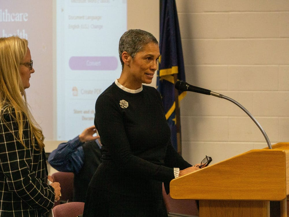 (Left to right) Meridian Health Services' Lisa Suttle, regional vice president of clinical services, and Tracy Douglas-Wheeler, vice president of community health, speak Jan. 14, 2020, at the Muncie Community Schools board meeting. Pending application and approval from the Health Resources and Services Administration, Southside Middle School might have its own health center before May. John Lynch, DN