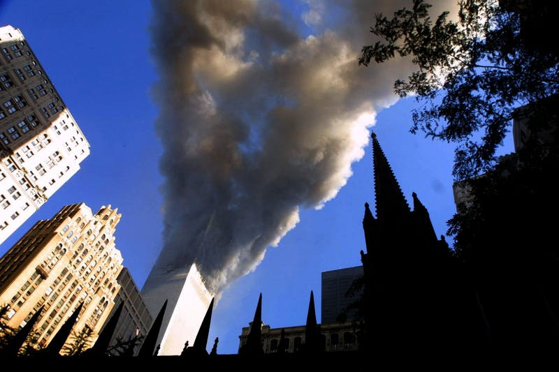 Smoke spews from a tower of the World Trade Center on Sept. 11, 2001, after two hijacked airplanes hit the twin towers in a terrorist attack on New York City. Jelani Eddington said he didn't realize both towers had been hit until someone pointed it out to him. Mario Tama/Getty Images/TNS, Photo Courtesy