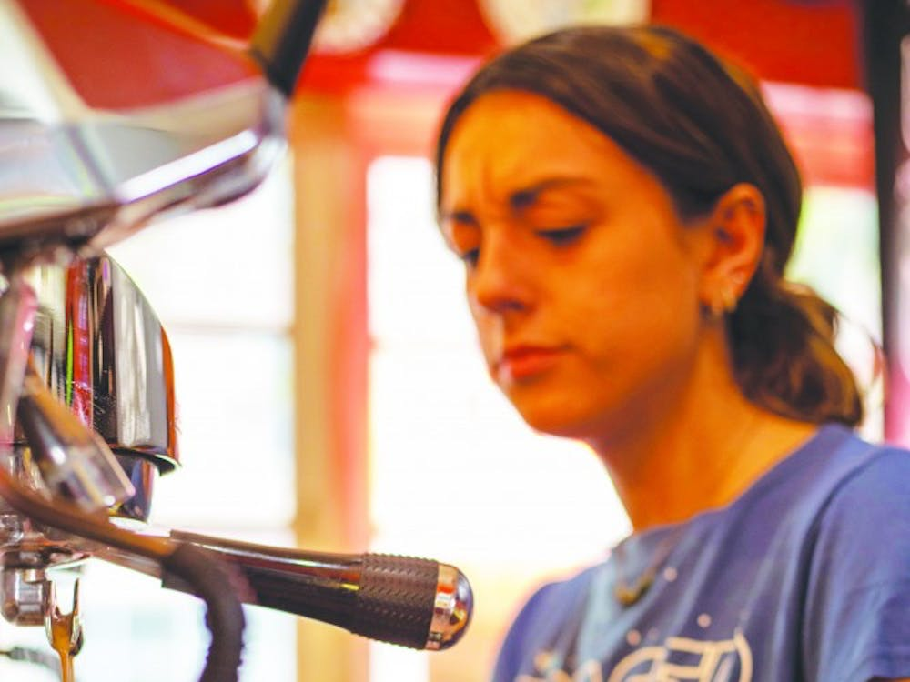 A worker at The Cup makes shots of espresso for a customer's drink Sept. 8, 2019. The Cup has offered drinks such as smoothies, teas, coffees and more since 2012. Jacob Musselman, DN.