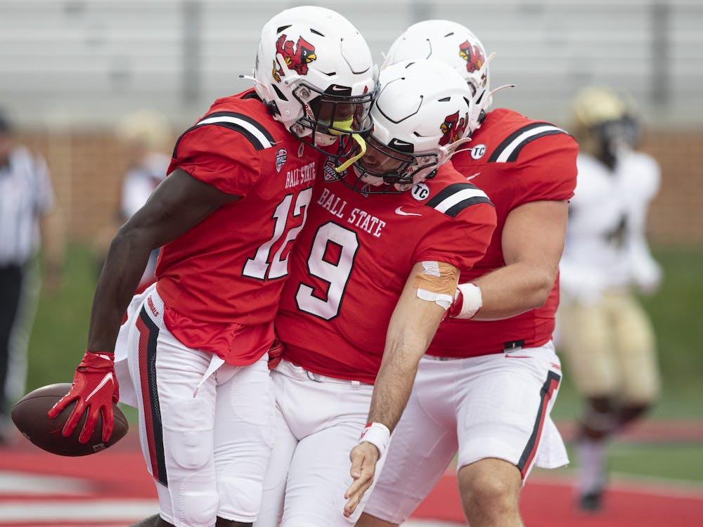 Cardinals junior wide receiver Jayshon Jackson celebrates a touchdown with redshirt fifth-year quarterback Drew Plitt Oct. 2, 2021, at Scheumann Stadium. The Cardinals beat the Black Knights 28-16. Jacob Musselman, DN