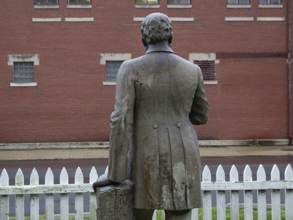 The statue of Charles Willard looks out at the East Washington Street outside Delaware County Historical Society. The statue was returned home to Muncie, after being gone in Tennesse for 50 years. Patrick Murphy,DN