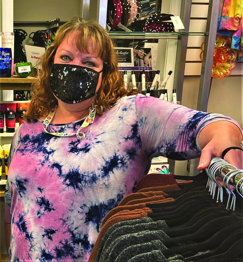 Judith Gill stands by a rack of tunics she sells Sept. 9, 2020, at Whimsies Boutique. Gill sells her tunics for $14-$20. Savannah Jordan, DN