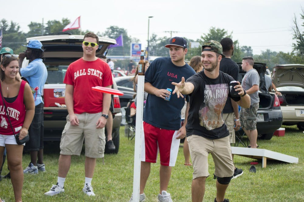 <p>Senior marketing major Brad Freidburger plays &quot;beersbee&quot; before the football game against Colgate University on Aug. 30, 2014 at the tailgate. The Scheumann Stadium overflow lot and the lawn of the Alumni Center are popular spots for tailgaters. <strong>Alaina Jaye Halsey, DN</strong></p>