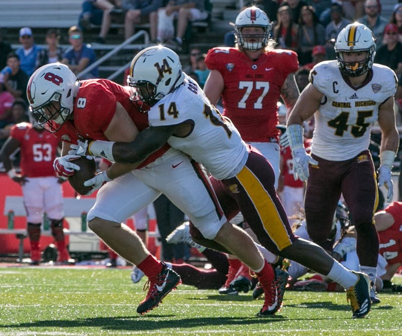 Redshirt junior fullback Cody Rudy attempts to run the ball during the homecoming game against Central Michigan Oct. 21, 2017, in Scheumann Stadium. The Cardinals fell, 56-9. Kaiti Sullivan, DN File