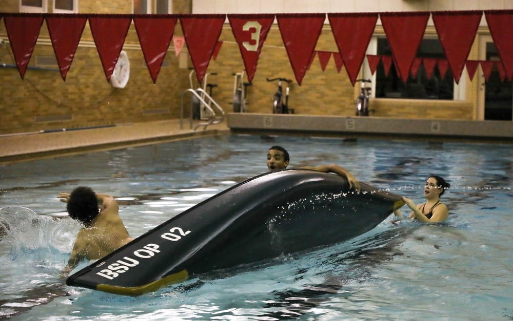 <p>Team Woody tips over after taking too much water from Team Exes and Flexes in the Championship Round Feb. 6, 2020, at Ball Gymnasium pool. Team Woody, was made up of freshmen Ronnie Coleman and Jordan Woods their team finished second overall. <strong>Hannah Gunnell, DN</strong></p>