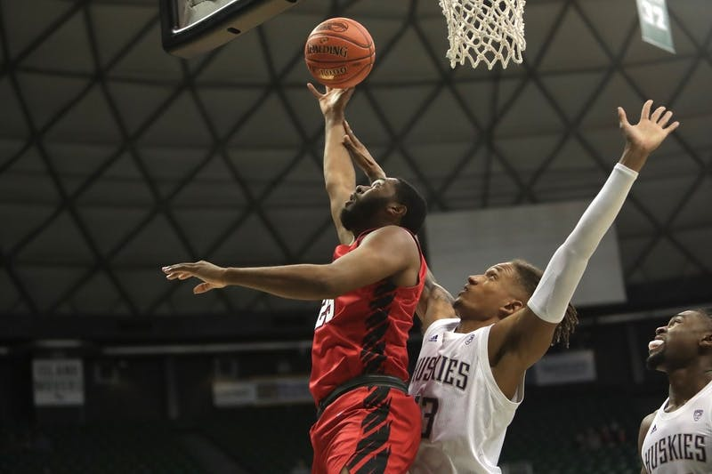 Redshirt senior forward Tahjai Teague battles for a rebound against a Huskie player in a game against Washington on Dec. 22 in the Diamond Head Classic in Honolulu, Hawaii. The Cardinals lost 85-64.  Ball State Athletics, photo provided