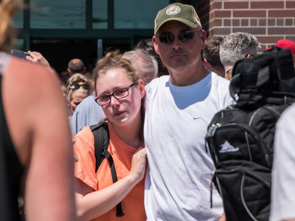 Noblesville High School students waited to be picked up after being put on lockdown due to a communicative threat and a school shooting at Noblesville West Middle School Friday, May 25. Parents waited in line more than 90 minutes to pick up their kids, though superintendent Beth Niedermeyer said there would be a regular release for those students who wouldn't be able to be picked up. Stephanie Amador, DN Photo