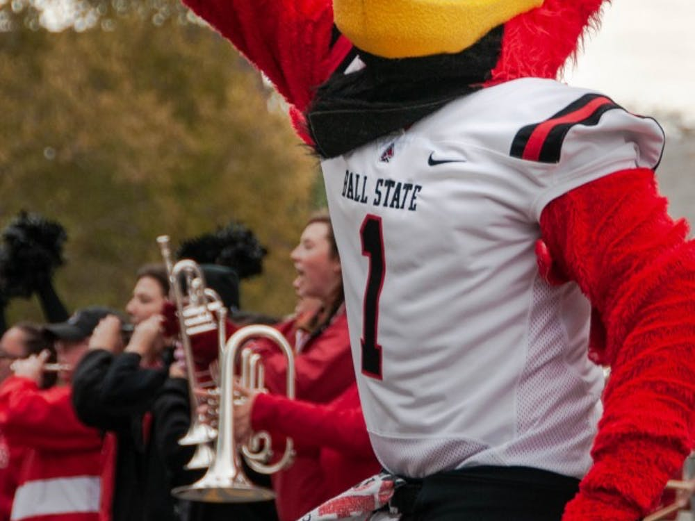 Charlie Cardinal cheers on competing during the annual Homecoming event, Bed Race Oct. 19, 2018, on Riverside Ave. Charlie was the final referee during the races Friday afternoon. Madeline Grosh,DN