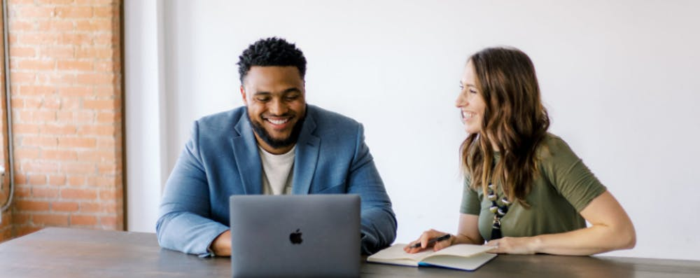 <p>Harold Hogue, CoSpero Consulting managing partner, talks with his business partner Lauren Coppedge. <strong>CoSpero Consulting, Photo Courtesy</strong></p>
