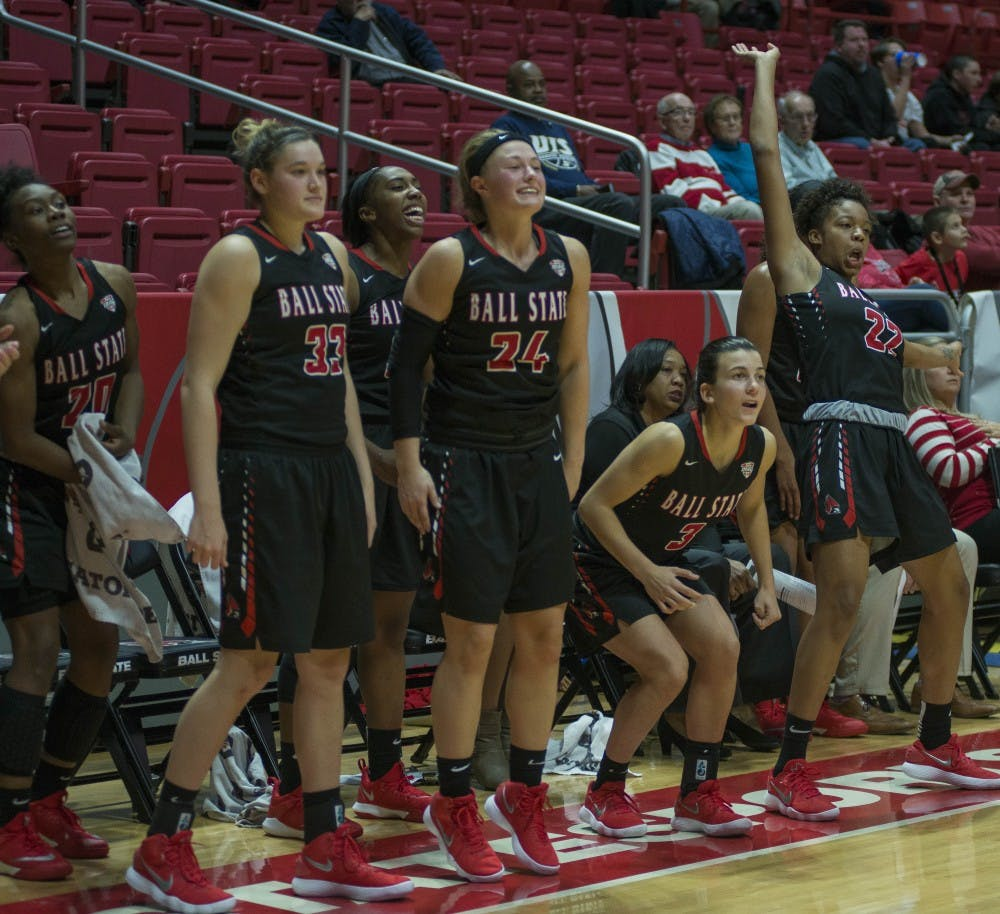 <p>Members of the women's basketball team watch a shot go up during the game against University of Illinois Springfield on Nov. 1 at Worthen Arena. <strong>Breanna Daugherty, DN</strong></p>