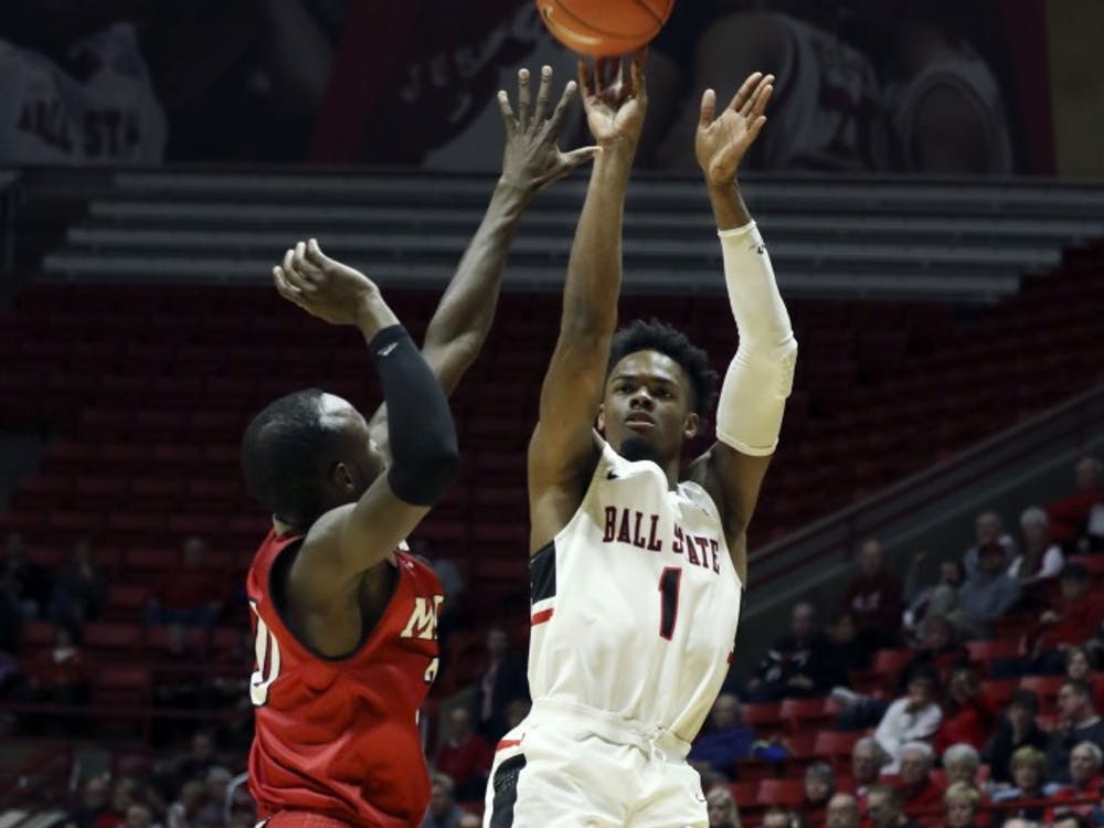 Ball State redshirt junior guard K.J. Walton shoots over the top of Miami's Abdoulaye Harouna during the Cardinals' game against the Redhawks Jan. 22 in John E. Worthen Arena. Walton was Ball State's leading scorer with 16 points. Paige Grider, DN
