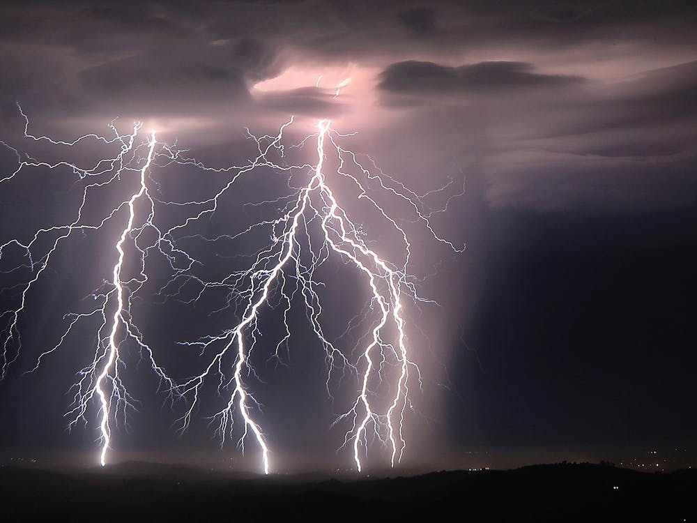 Step leaders branch out from cloud to ground lightning strikes, Sunday, Aug. 16, 2020, as an early morning storm rips across the Santa Rosa plain near Healdsburg, Calif. (Kent Porter/The Press Democrat via AP)