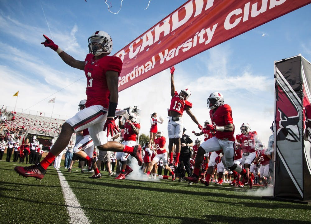 <p>Ball State players rush the field through smoke and confetti before the homecoming game against Central Michigan, Oct. 21 at Scheumann Stadium. Ball State lost to Central Michigan, 9-56. <strong>Grace Hollars, DN</strong></p>