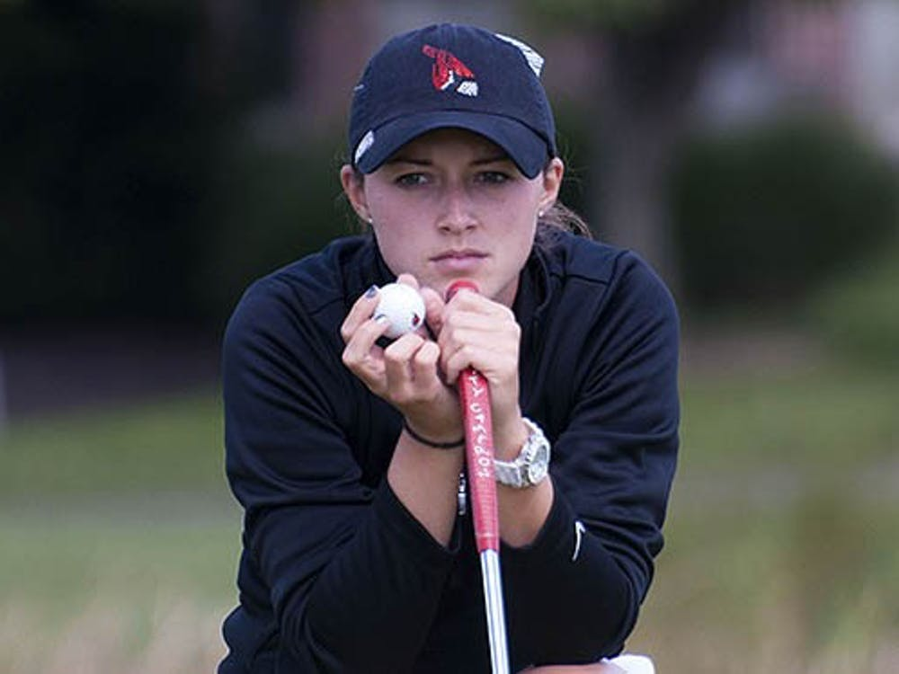 Junior Meghan Perry lines up a putt during the Cardinal Classic in September 2012. The women's golf team will compete in their first meet since October 2012 on Sunday in the Jim West Challenge in Blanco, Texas. DN FILE PHOTO BOBBY ELLIS