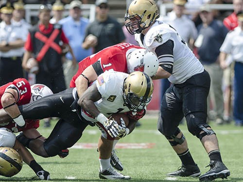 Ball State linebacker Ben Ingle goes for the sack against Army in the third quarter of the game on Sept. 7. Ball State would overtake Army with a final score of 40-14. DN PHOTO COREY OHLENKAMP