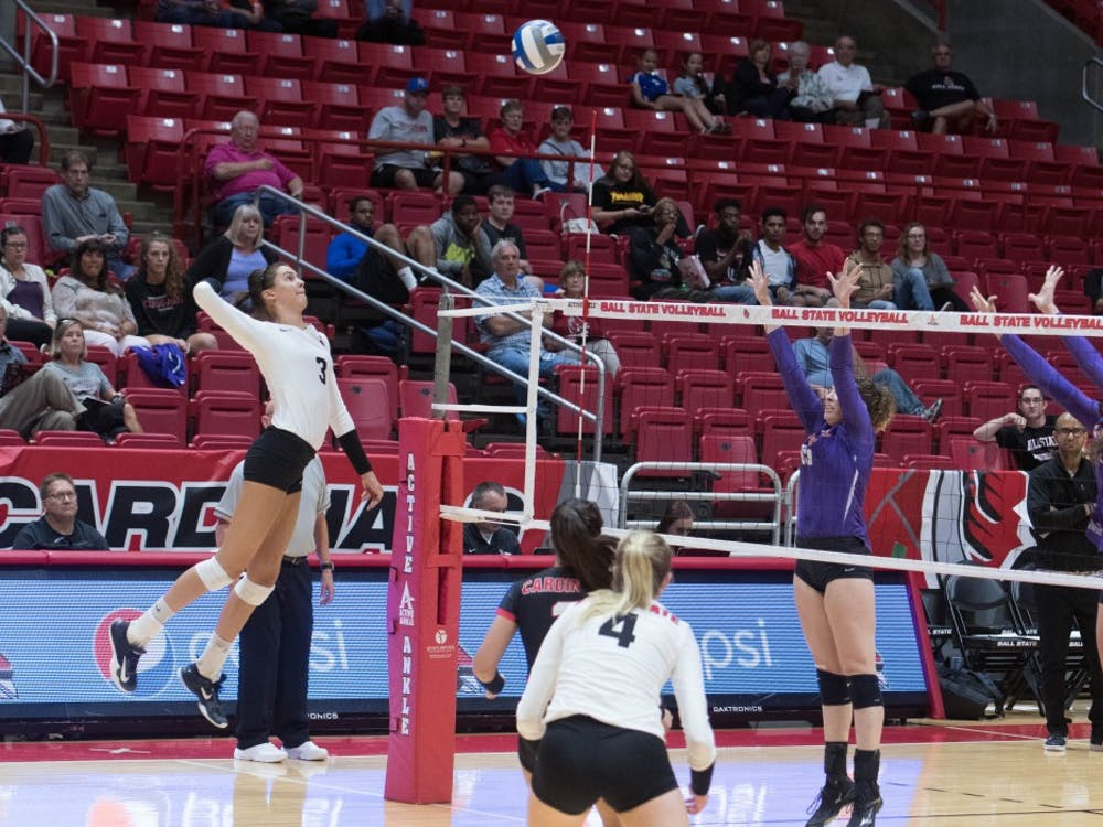 Junior outside hitter Brooklyn Goodsel spikes the ball at the game against Evansville on Sept.14 at John E. Worthen Arena. The Cardinals had 44 kills. Emily Coats, DN