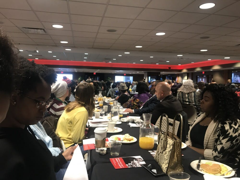<p>Muncie community members eat breakfast at the MLK Community Breakfast Monday, Jan. 21, in Cardinal Hall at the L.A. Pittenger Student Center. Ball State president Geoffrey Mearns gave a speech based on unity and community.<strong> Gabbi Mitchell, DN</strong></p>