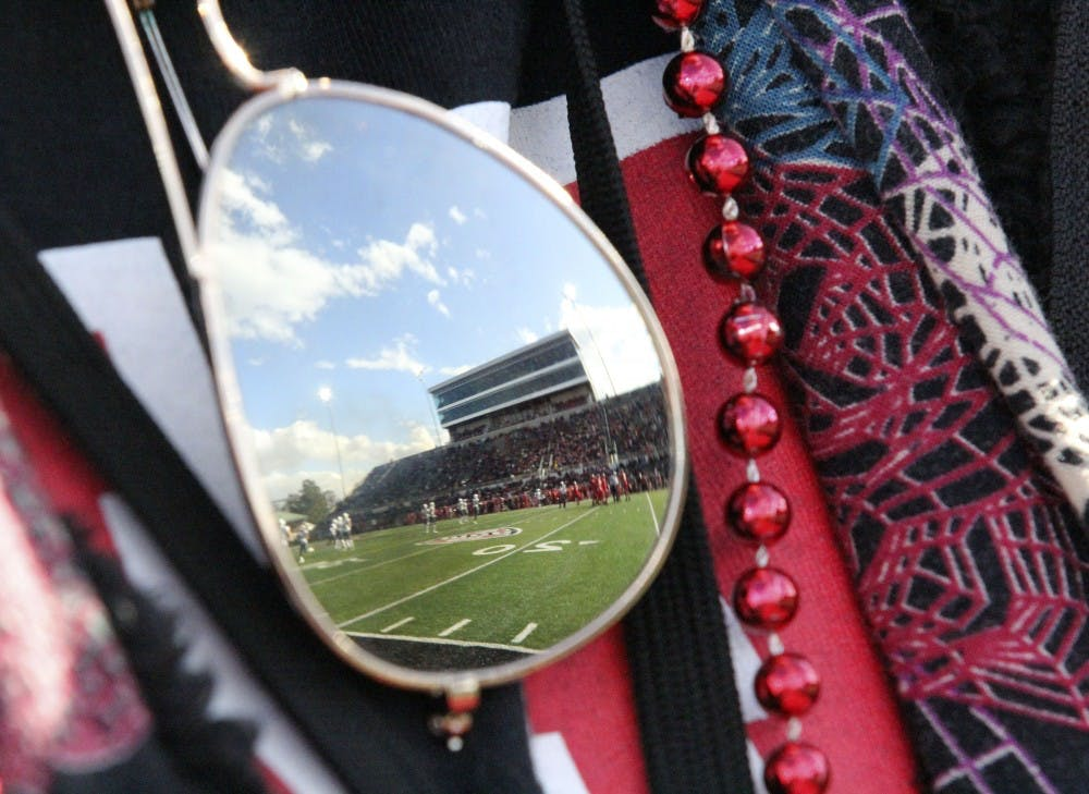 <p>Schuemann Stadium reflects off of a fan's sunglasses during Ball State's game against Eastern Michigan Oct. 20, 2018. Ball State lost 42-20 on Homecoming. Paige Grider, DN</p>