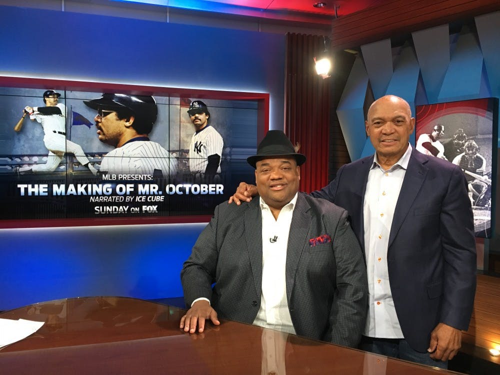 Former Ball State football player Jason Whitlock (left) poses with Reggie Jackson (right) on the set of hisT.V. sports show Speak For Yourself. Whitlock also writes for ESPN and has over252,000 followers on Twitter.Jason Whitlock // Photo Provided