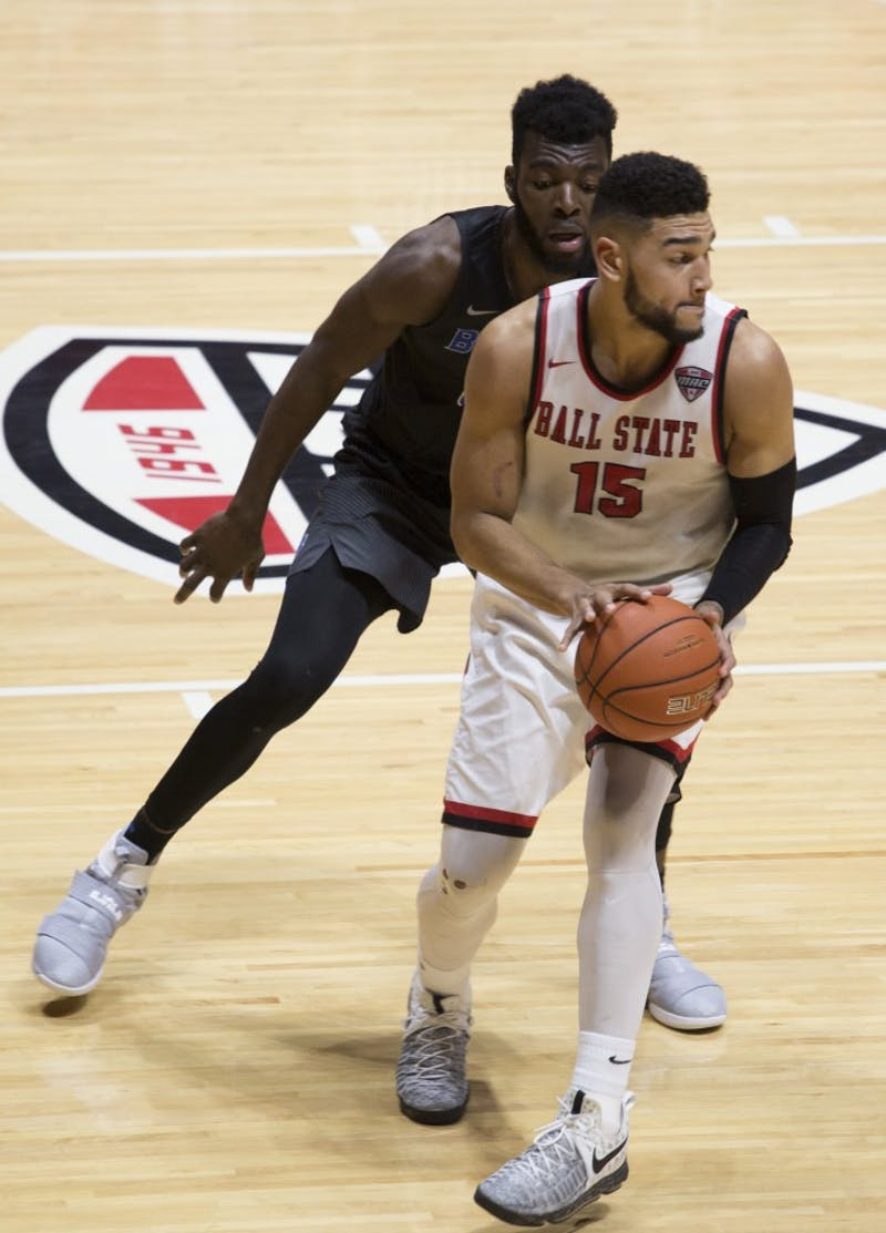 Senior forward Franko House looks for an open teammate during the game against Buffalo on Feb. 3 at Worthen Arena. Ball State lost 96-69. Emma Rogers // DN
