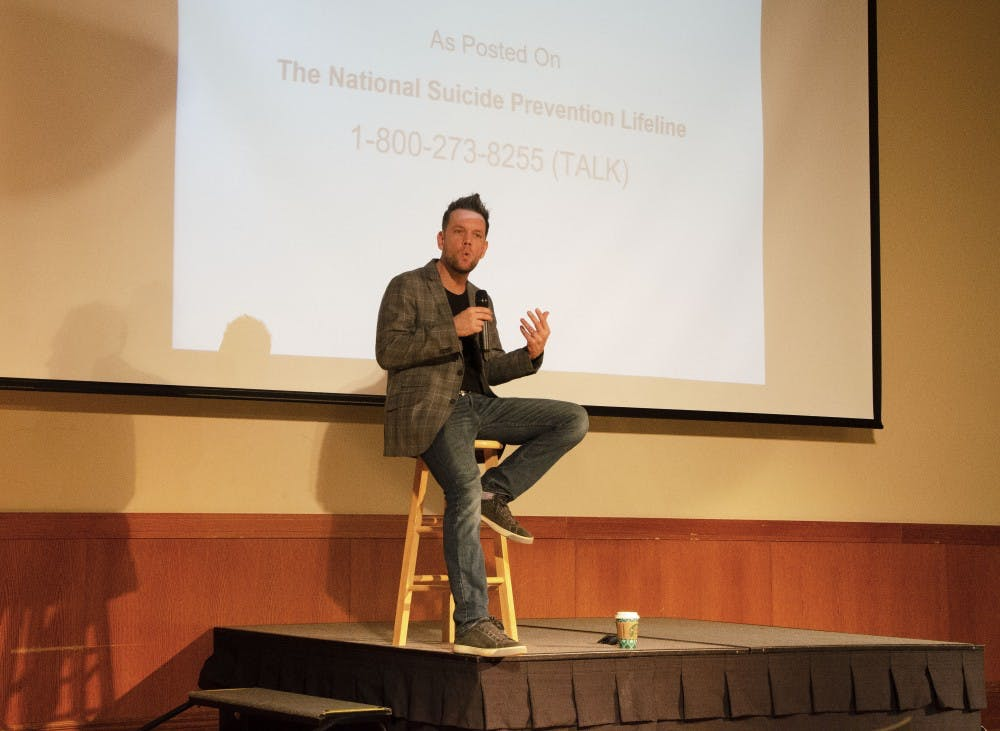 """Josh Rivedal recounts his past Nov. 28, 2018, in the Student Center Ballroom. Rivedal offered advice about staying aware of those around us and the importance of mental health in his program """"The i'Mpossible Project"""" hosted by SGA and Greek Life. Pauleina Brunnemer,DN."""