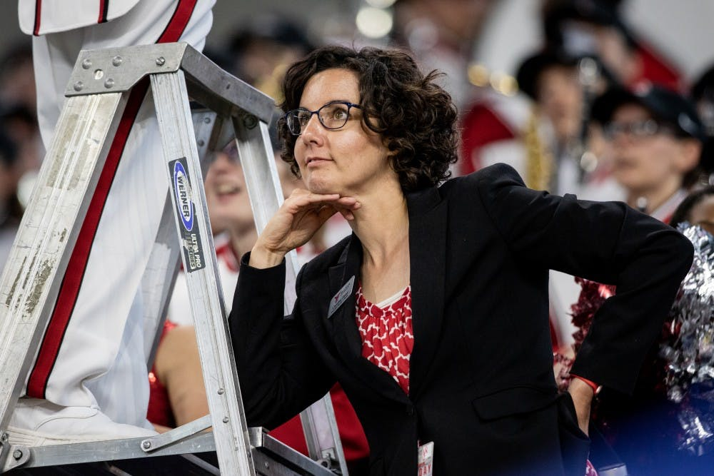 <p>Caroline Hand, associate director of bands, looks on as Ball State football played Indiana University in Lucas Oil Stadium, Aug. 31, 2019. The band practices three times a week. <strong>Eric Pritchett, DN</strong></p>