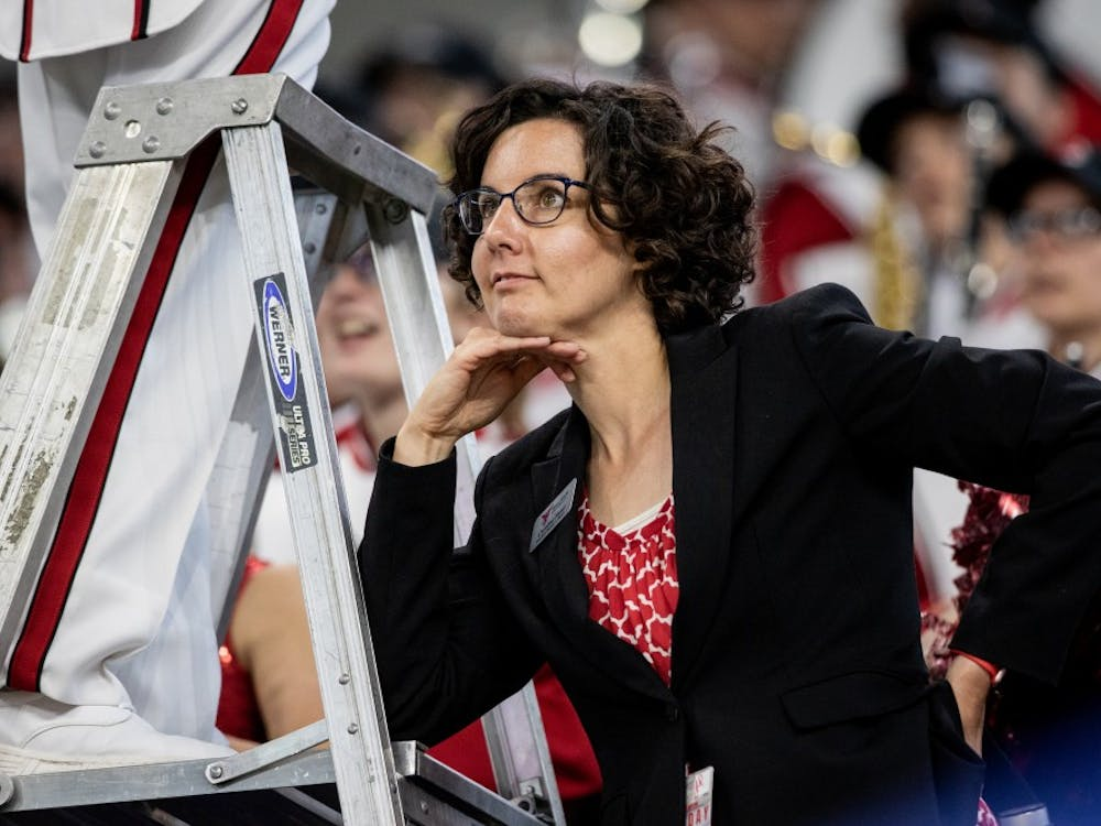 Caroline Hand, associate director of bands, looks on as Ball State football played Indiana University in Lucas Oil Stadium, Aug. 31, 2019. The band practices three times a week. Eric Pritchett, DN