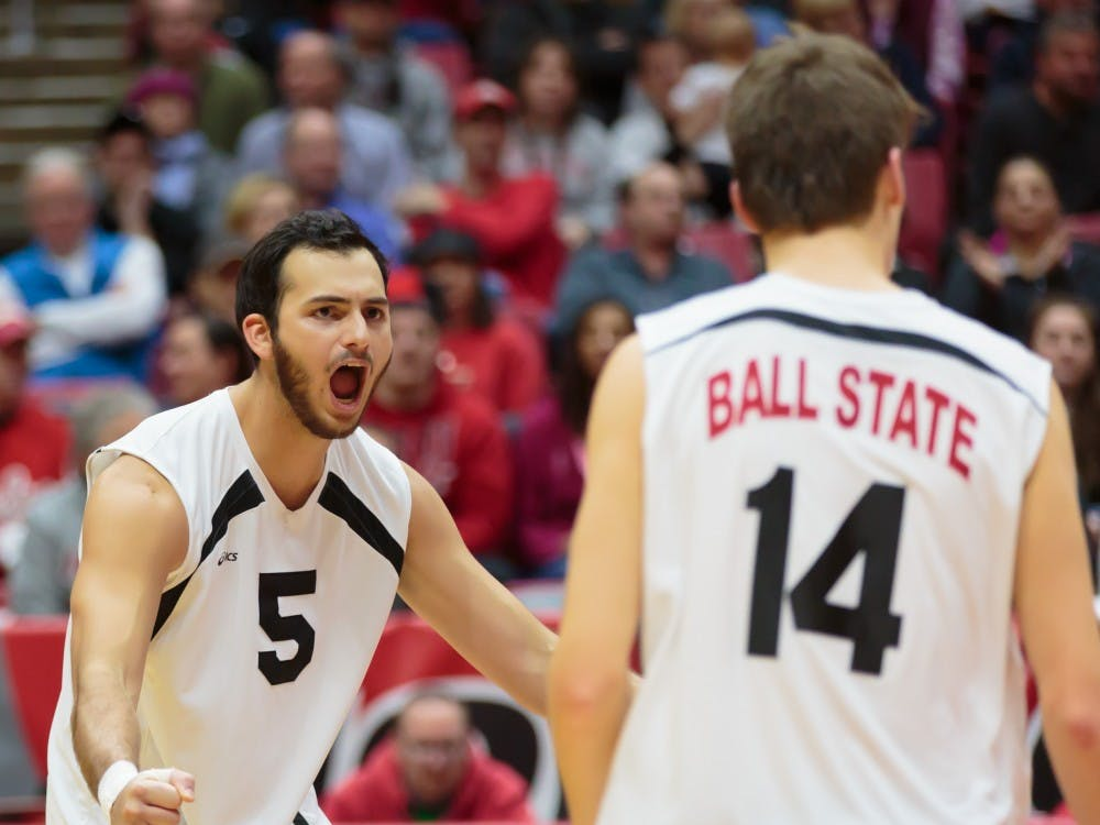 Senior outside attacker Edgardo Cartagena celebrates after a score during the game against Ohio State on Feb. 2 in John E. Worthen Arena. The Cardinals lost 0-3. Kyle Crawford // DN