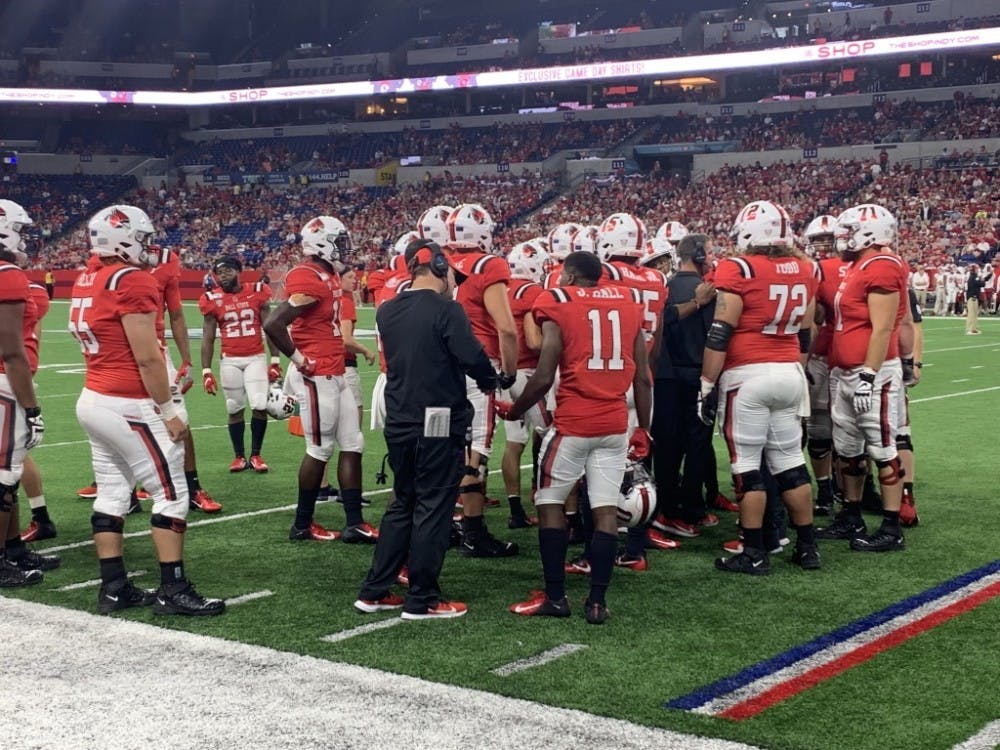 Ball State's football team huddles together during a time-out to discuss strategies during the 2019 Ruoff Kickoff Classic against Indiana University.