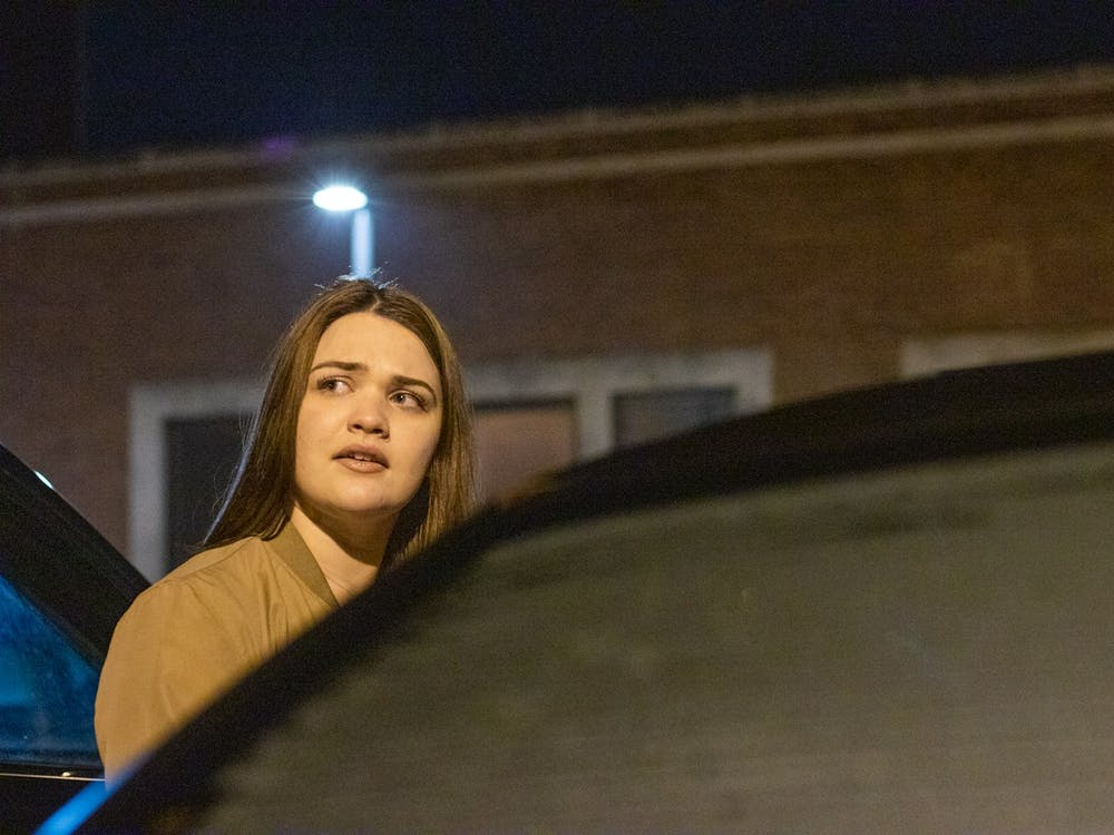 "Rhyan Radabaugh gets out of her car Jan. 14, 2020. ""Always park under a streetlight,"" Radabaugh said. Jacob Musselman, DN Illustration"