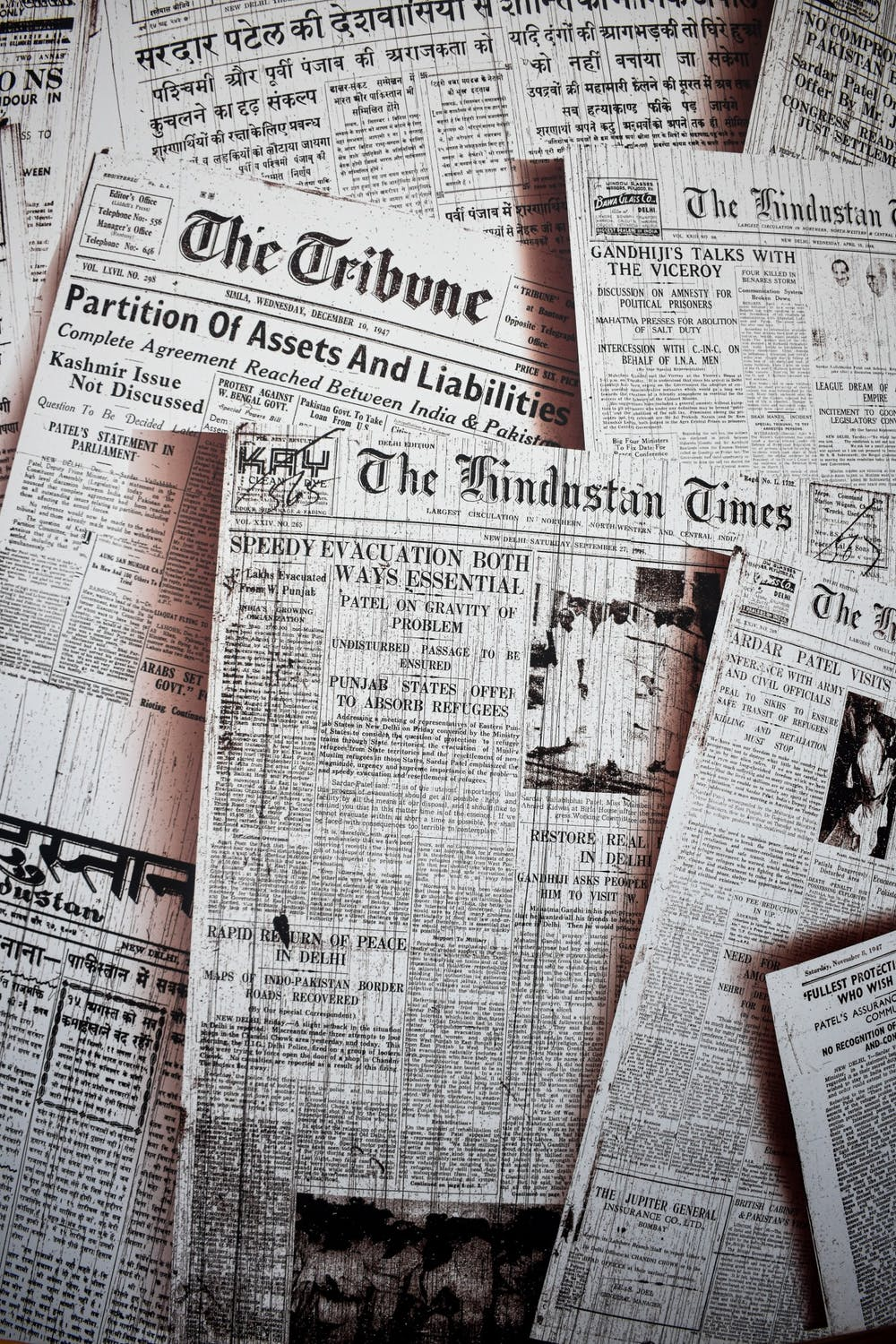 <p>Archived newspapers are sprawled out for a photo. The freedom of the press has allowed newspapers to run for more than 230 years. <strong>Unsplash, Photo Courtesy</strong></p>