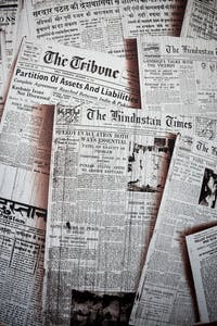 Archived newspapers are sprawled out for a photo. The freedom of the press has allowed newspapers to run for more than 230 years. Unsplash, Photo Courtesy