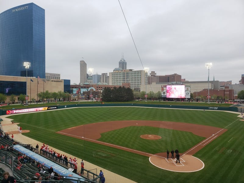Ball State Baseball players and coaches line up for the national anthem for their game against Indiana April 23 at Victory Field in Indianapolis. The Cardinals fell to the Hoosiers, 9-3. Zach Piatt, DN