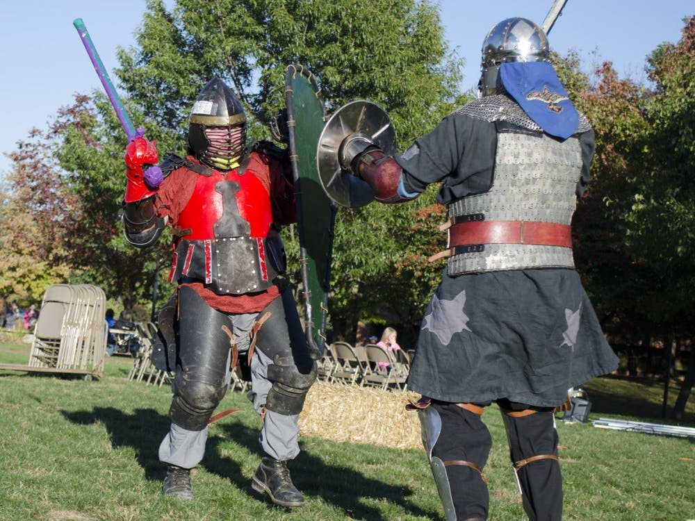 Members of Shadow Star take part in a combat exposition at the Renaissance Faire Oct. 16 on the University Green. DN PHOTO BREANNA DAUGHERTY