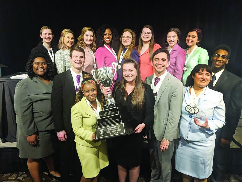 The Ball State Speech Team holds their trohpies after winning the National Speech Championship March 24 in Rochester, Michigan. The team also secured three individual national titles alongside their team win. Ball State Speech Team, Photo Provided
