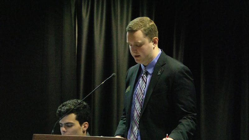 Student Government Association Vice President Cameron DeBlasio reads a new resolution aloud to the senate Sept. 18 at the L.A. Pittenger Student Center . The resolution would require all Ball State restrooms to be equipped with sanitary dispensaries. John Lynch, DN