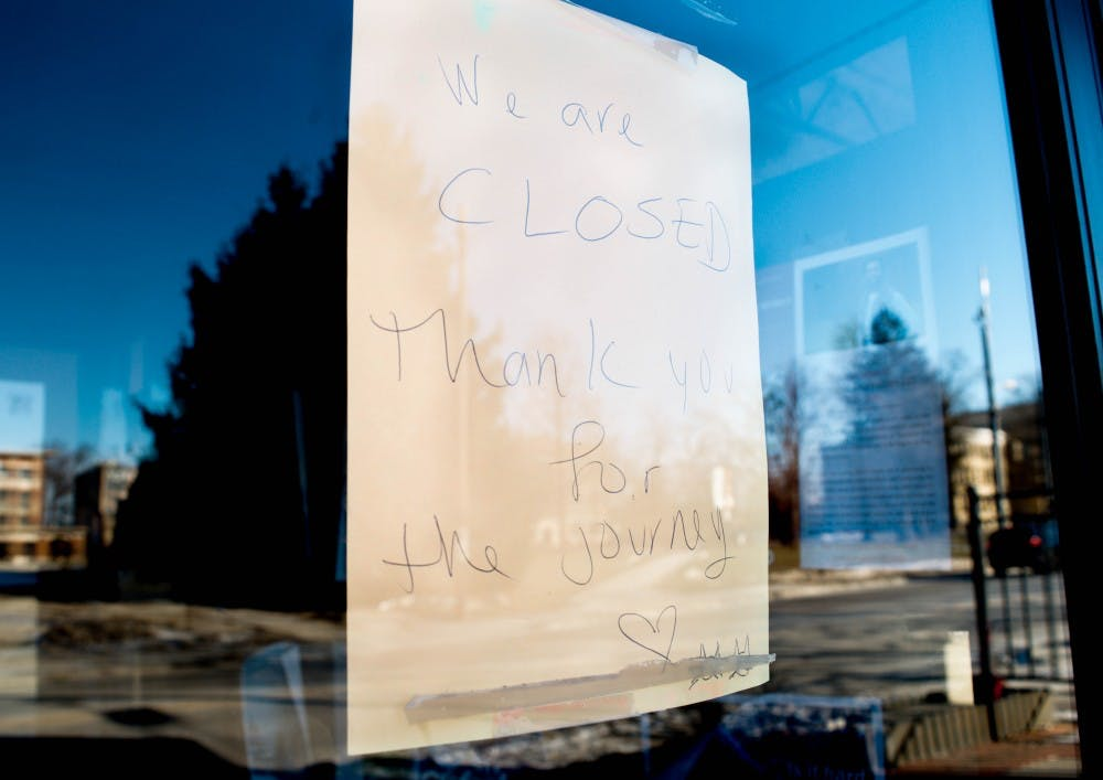 """<p>A sign that says """"We are closed. Thank you for the journey,"""" is pasted on the window of what used to be Muncie's Two Cats Cafe. Two Cats closed their doors Dec. 13, 2018, after owner Basam Helwani accepted an offer with Pocket Points. <strong>Mallory Huxford, DN</strong></p>"""
