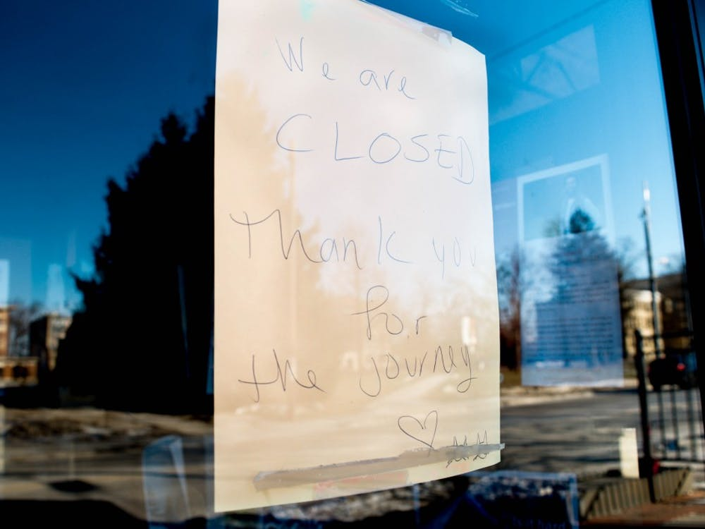 """A sign that says """"We are closed. Thank you for the journey,"""" is pasted on the window of what used to be Muncie's Two Cats Cafe. Two Cats closed their doors Dec. 13, 2018, after owner Basam Helwani accepted an offer with Pocket Points. Mallory Huxford, DN"""