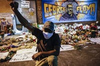 Protesters gather at a memorial for George Floyd where he died outside Cup Foods on East 38th Street and Chicago Avenue, June 1, 2020, in Minneapolis. Protests continued following the death of Floyd, who died after being restrained by Minneapolis police officers on May 25. (AP Photo/John Minchillo)