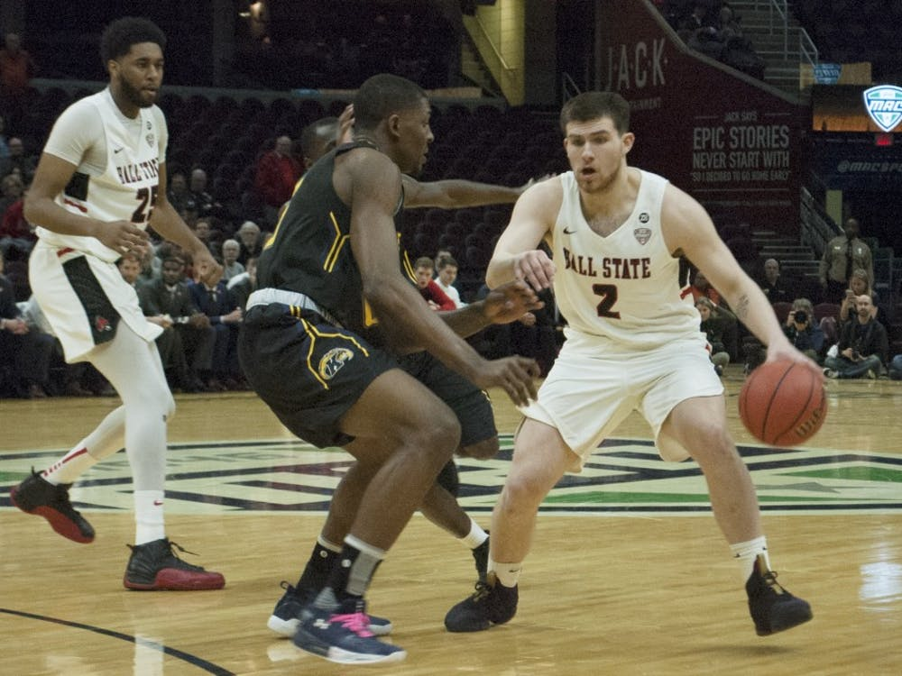 Tayler Persons dribbles past a Kent State defender during the Mid-American Conference Tournament quarterfinals. Robby General, DN