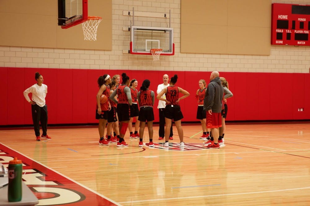 <p>The team huddles up to take direction for head coach Brady Sallee during a practice at Dr. Don Schondell Practice Center on Dec 5, 2018. <strong>Gabi Glass,DN</strong></p>