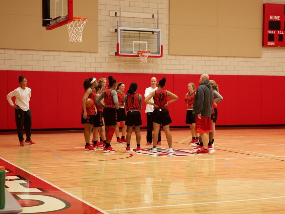 The team huddles up to take direction for head coach Brady Sallee during a practice at Dr. Don Schondell Practice Center on Dec 5, 2018. Gabi Glass,DN