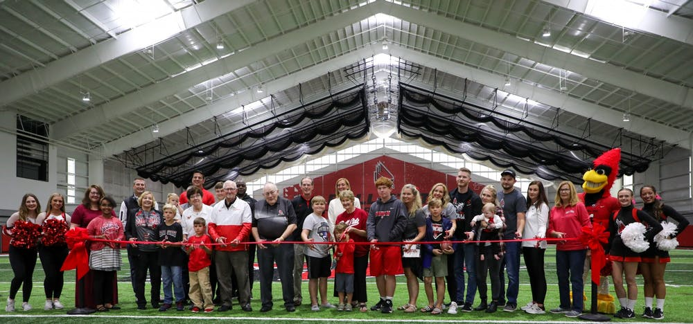 <p>The Scheumann family, President Geoffrey Mearns, Beth Goetz and members of the Ball State community gathered to cut the ribbon at the Scheumann Family Indoor Practice Facility ribbon-cutting ceremony Saturday, October 2nd. Mearns said Scheumann embodied Ball State in all areas of his life. <strong>Daniel Kehn, DN</strong></p>