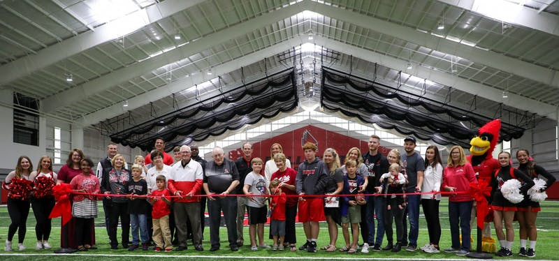 The Scheumann family, President Geoffrey Mearns, Beth Goetz and members of the Ball State community gathered to cut the ribbon at the Scheumann Family Indoor Practice Facility ribbon-cutting ceremony Saturday, October 2nd. Mearns said Scheumann embodied Ball State in all areas of his life. Daniel Kehn, DN