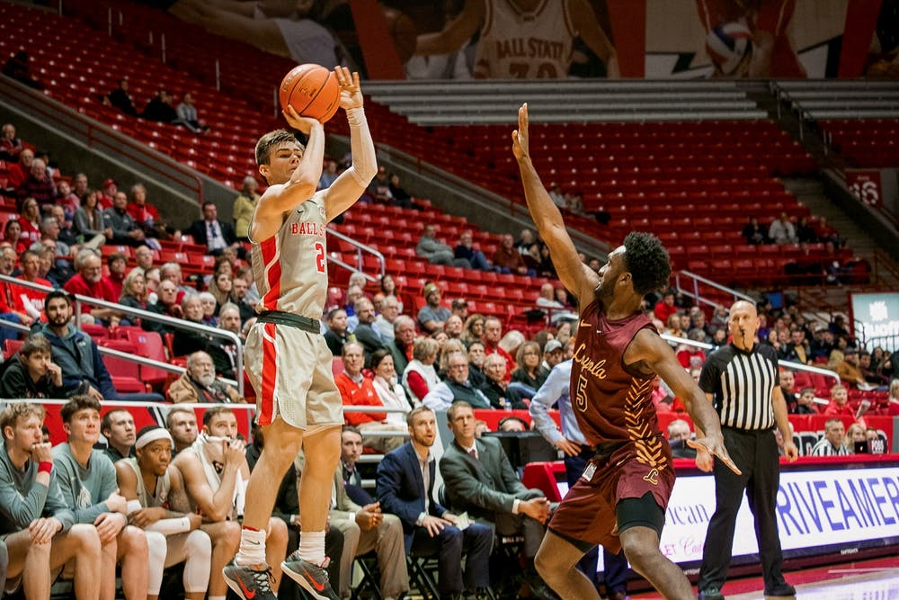<p>Freshman guard, Luke Bumbalough (2), spots up for a three point attempt against Loyola Chicago Dec. 3, 2019, in John E. Worthen Arena. Bumbalough finished with two three pointers for the night, the Cardinals are now 4-4 on the season after their loss to Loyola. <strong>Omari Smith, DN</strong></p>